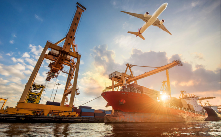 Image representing trade with boat full of shipping containers, and a plane overhead